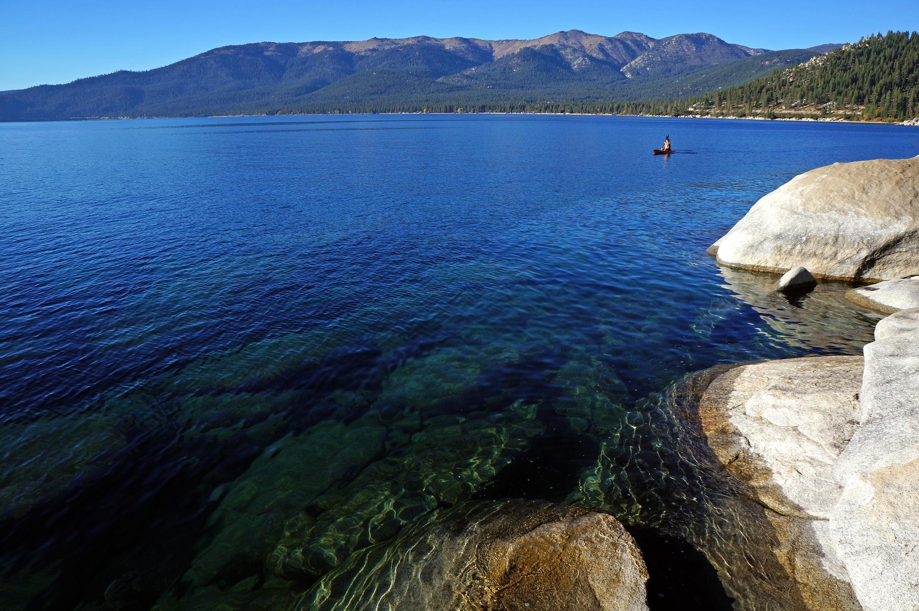 kayaker along the east shore of Lake Tahoe, Nevada