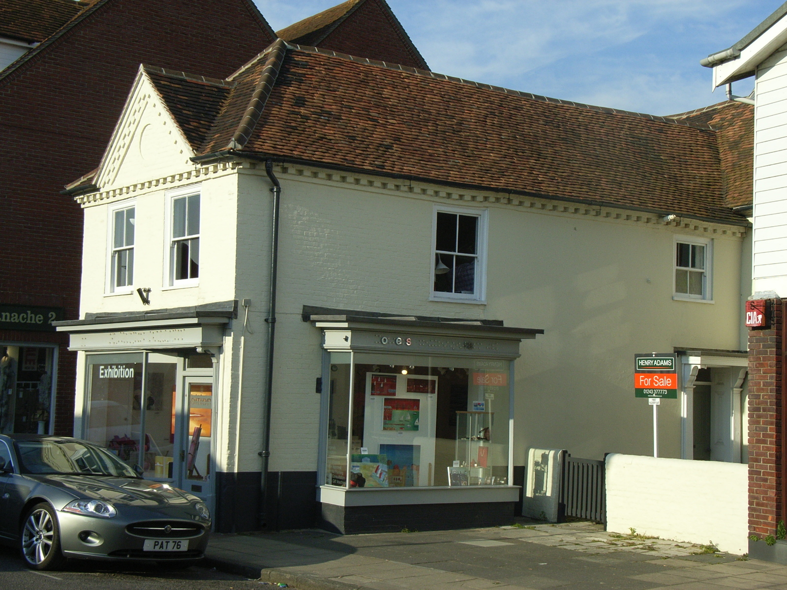 conversion from old pharmacy to 3 flats and reduced retail unit